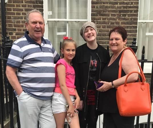 Help - Lucy Pritchard with her family who are supporting her work