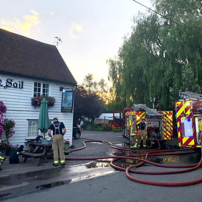 Scene - fire crews outside pub