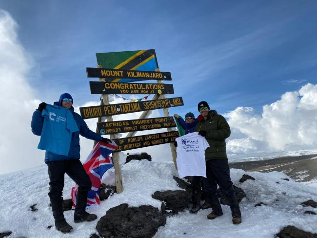 Summit - Tony and Bev Turner and Glen Robinson at the top of Mount Kilimanjaro