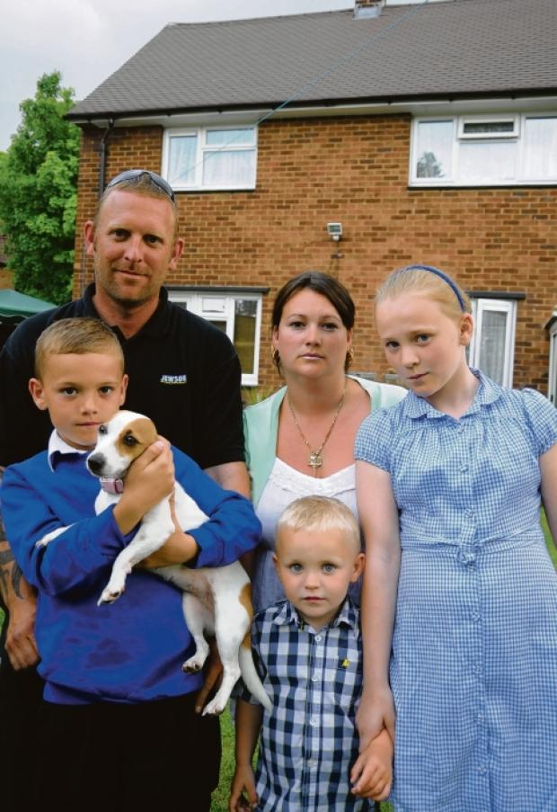 Gassed – Karine and Dean Whitehead with their children Baylon, Sekeilie and  Caysen and the family's dog