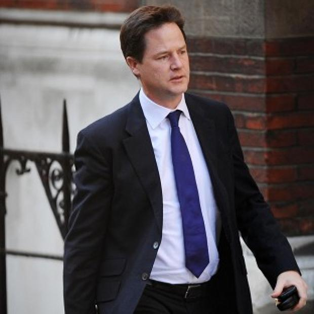 Deputy Prime Minister Nick Clegg arrives at the Leveson Inquiry into press standards at the Royal Courts of Justice in London