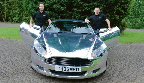 Petrol-heads – Perry Cox and Tony Harris with their chrome Aston Martin DB9