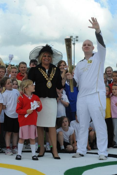Torch relay comes to town. Marc Grayston, with the torch and mayor Mo Larkin