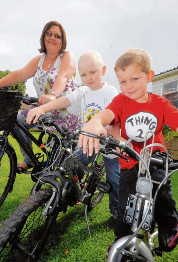 Bikeathon here we come – Robert Hucker with mum Heather and brother, Thomas, five