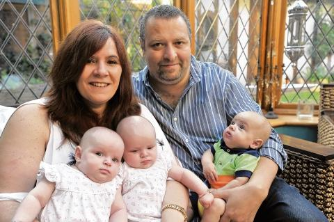 Gordon and Carolyne Goodall with triplets Indiya, Freyah and Frederik, and Dominick, 11, Izabella, eight, and Madelayne 13. Missing from the picture is Cameron, 15