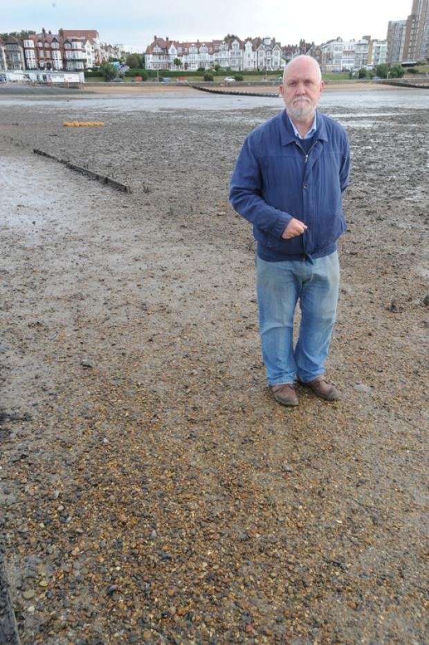 Councillor David Norman on a newly exposed causeway