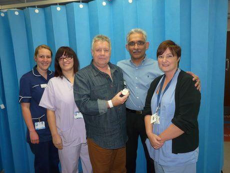 Roy Harrington with consultant cardiologist Dr Sajjad Mazhar and (l to r) cardiac day stay deputy manager Katie Schirn, senior chief physiologist Katy Deane and principal physiologist Nikki Baines.