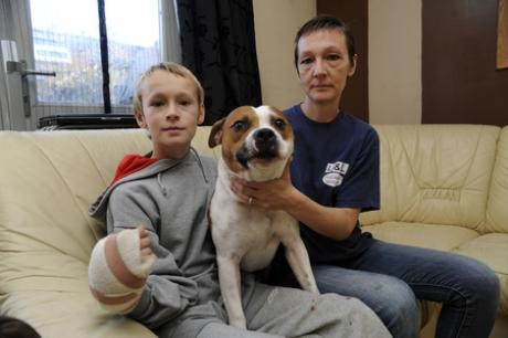 Injured - Connor Houghton with mum Lisa and their dog Onyx.