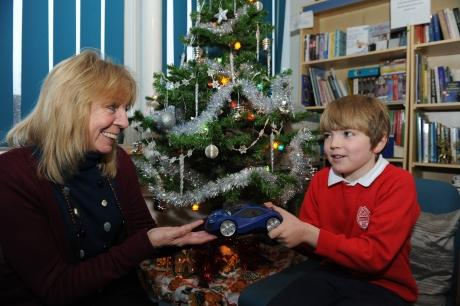 Kind hearted boy donates moneybox to charity