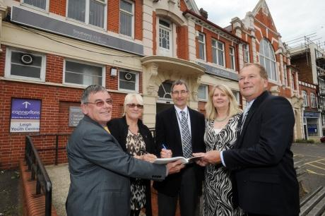 Leigh Town Council councillors sign the lease on the community centre last year