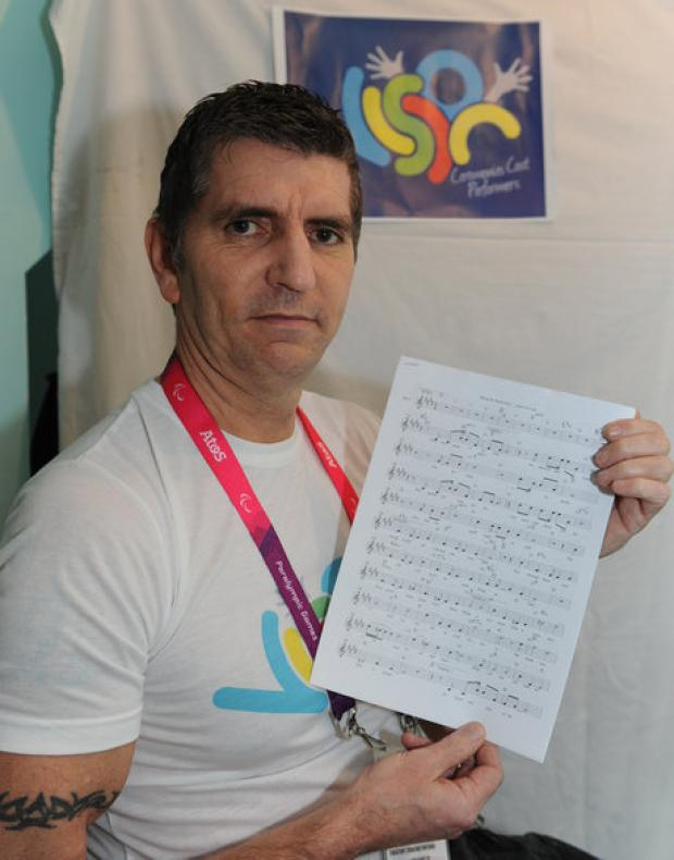 Volunteer writes Olympic song after inspirational event