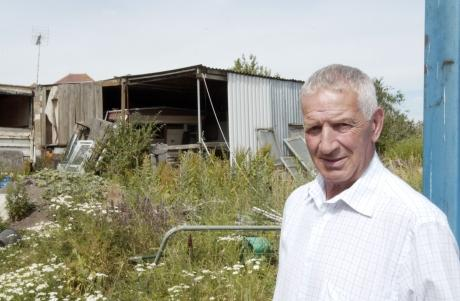 Pensioner who ran illegal dump fined £35,000