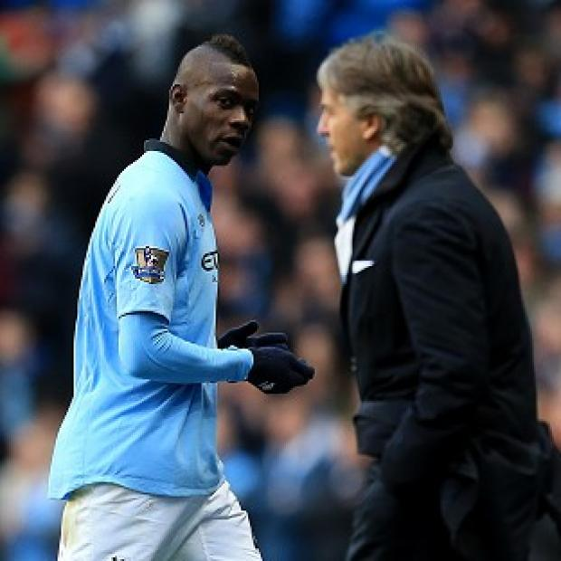 Roberto Mancini, right, bade Mario Balotelli, left, farewell this week