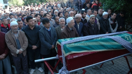 Crowds pay their respects at the funeral of murdered Leigh man Omer Kaya in Demre, southern Turkey