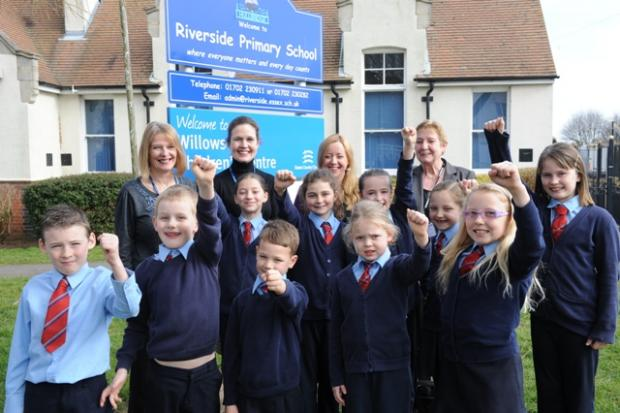 Riverside Primary School children celebrate with back row L-R Head teacher Megan Jenkins, Emma Shaw deputy head, Val Lucking chairman of Governors and KimAdams Assistant head teacher.