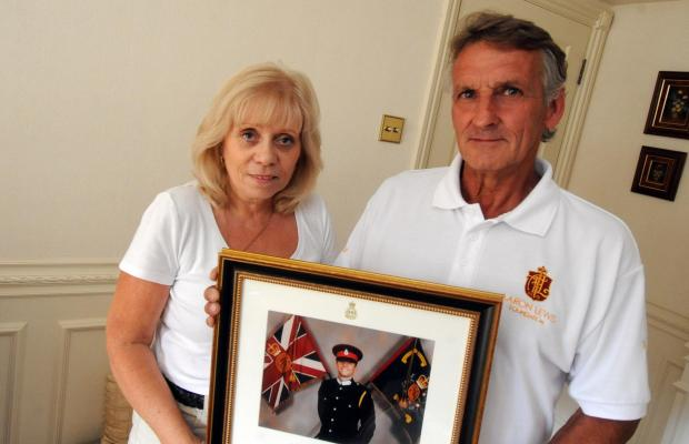 Mum and dad Helen and Barry Lewis with a picture of son Aaron