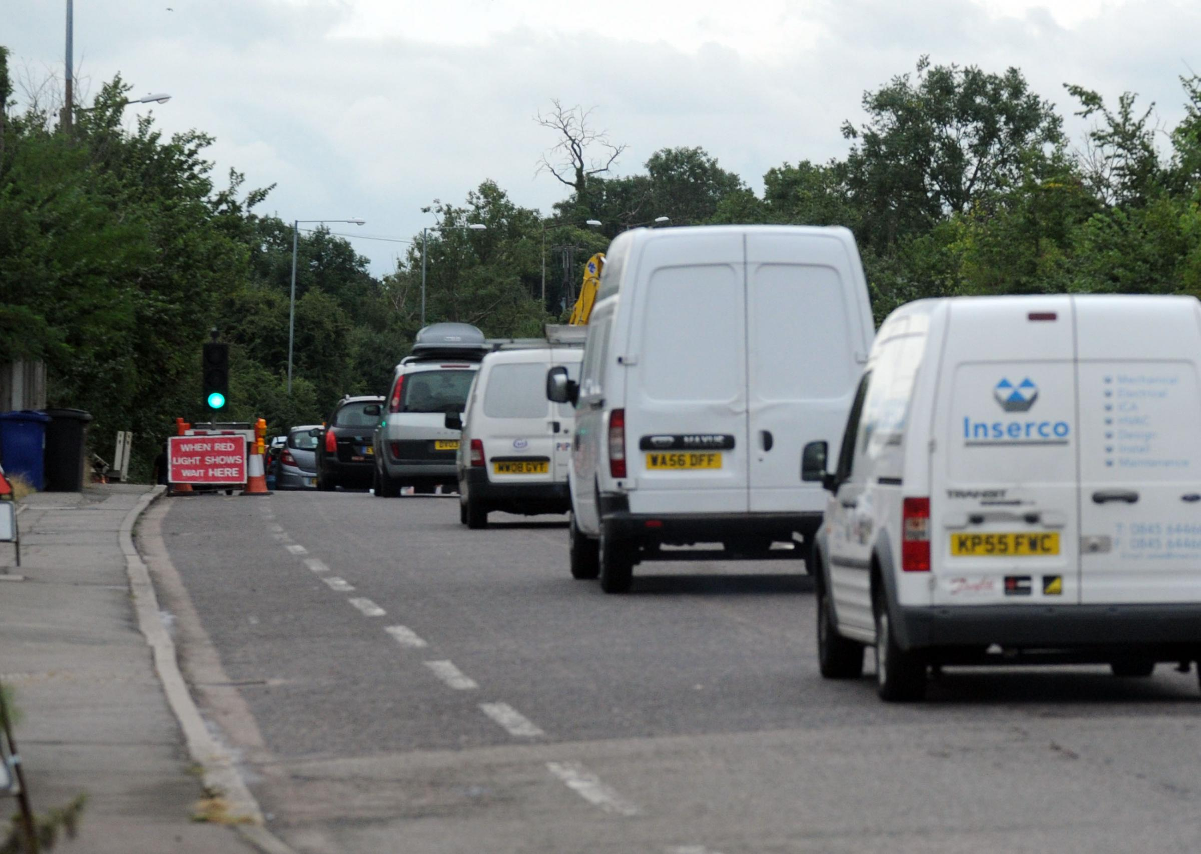 Tailbacks – traffic queuing at temporary lights set up by workers hooking up power to the traveller site
