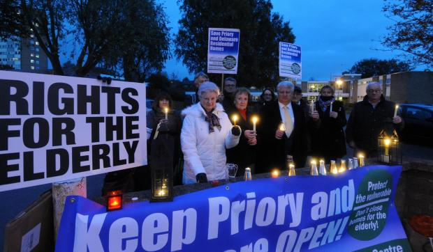 Southend Standard: Campaigners hold a vigil outside Priory House