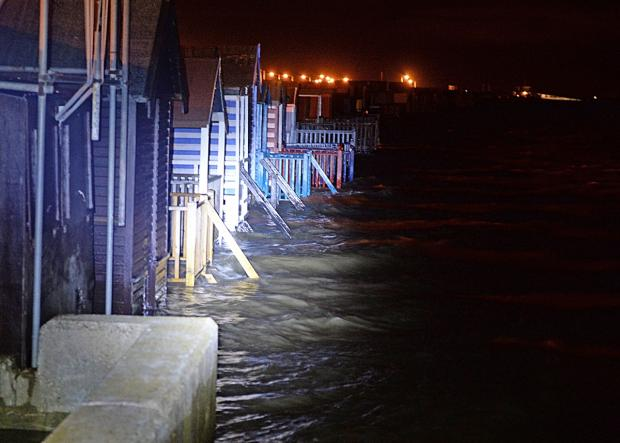 Southend Standard: Beach huts flooded at shoebury