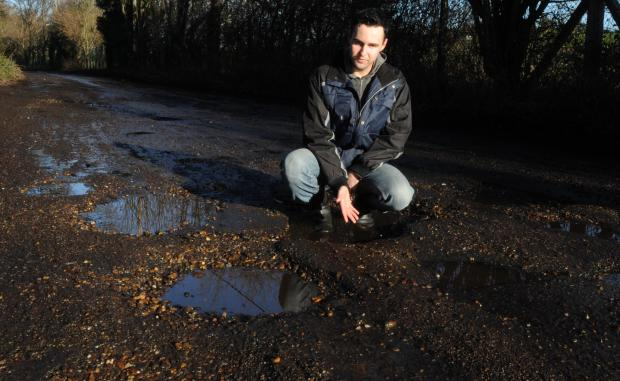 Road full of holes needs urgent work