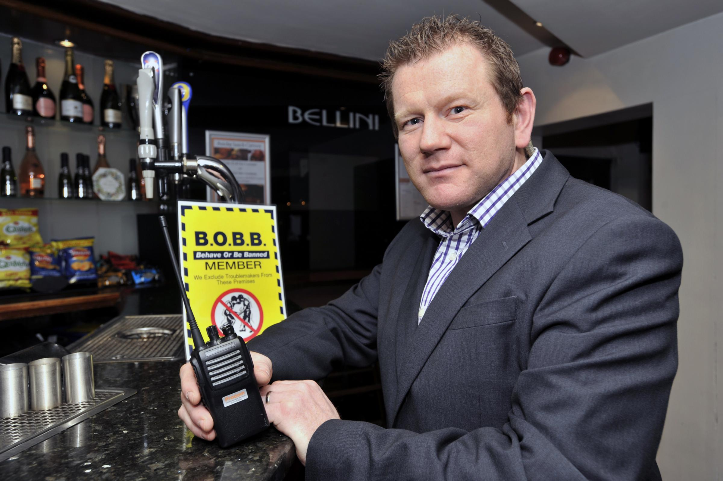 Les Harrison of Bellini's with one of the new radios bought by