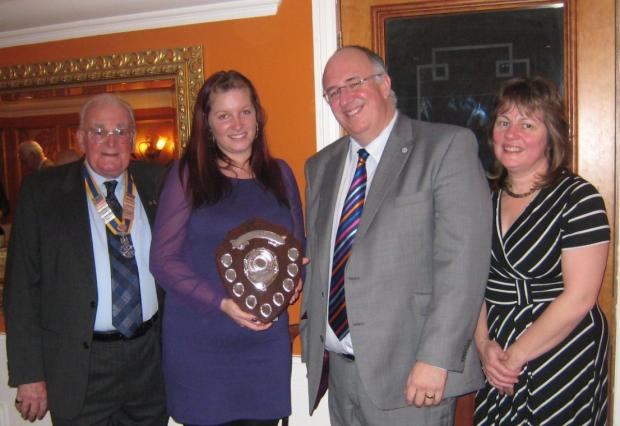 Victoria Young is presented with her award by Simon Jones, wife Carol and club president Ron Price