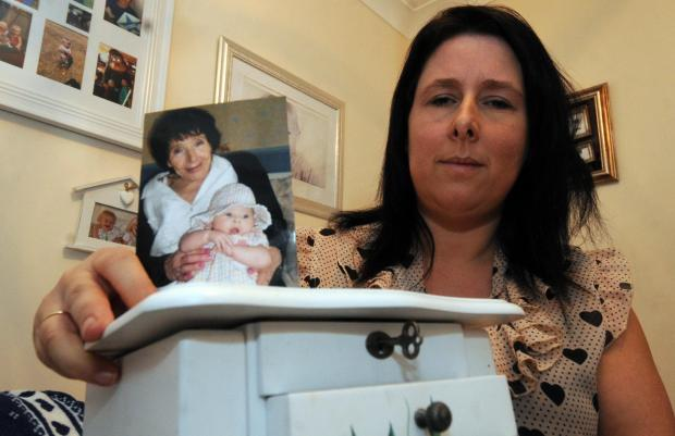 Becky Williams with her empty jewellery box and a picture of her mum