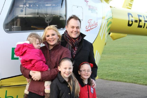 The Moon family at Essex Air Ambulance base in Earls Colne. Mum Nicola, dad David, Maisie and sisters Ella and Melissa
