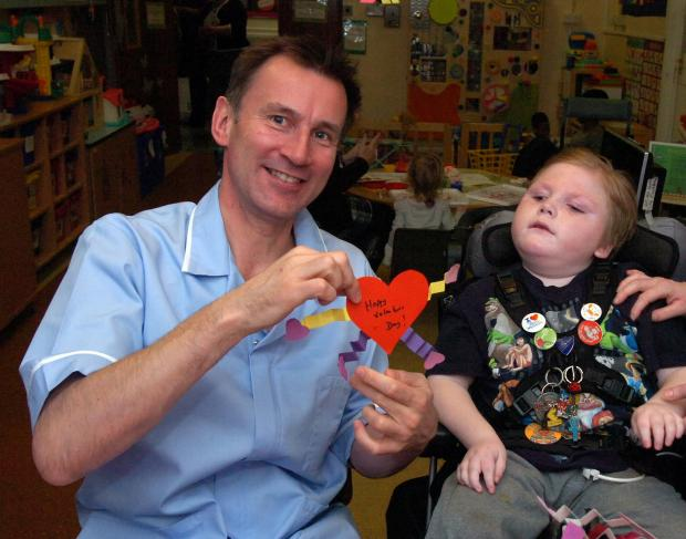 Jeremy Hunt and patient Callum Miller, 8, on the children's war