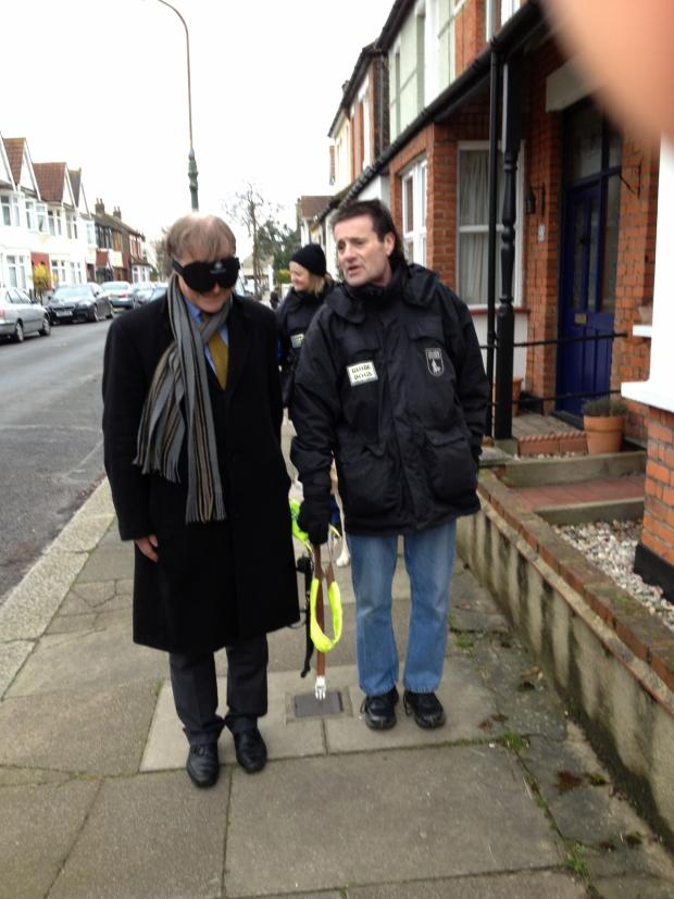 Southend Standard: David Amess being led through Leigh by Guide Dogs for the Blind mobility instructor Norman McIver