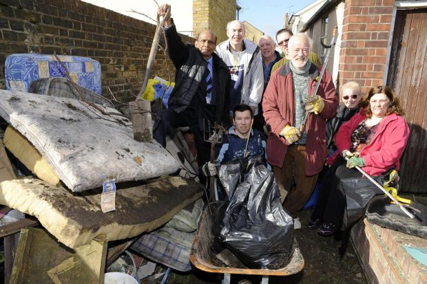 Team effort – councillor Paul Collins, David Webb and their volunteers at work in the alleyway