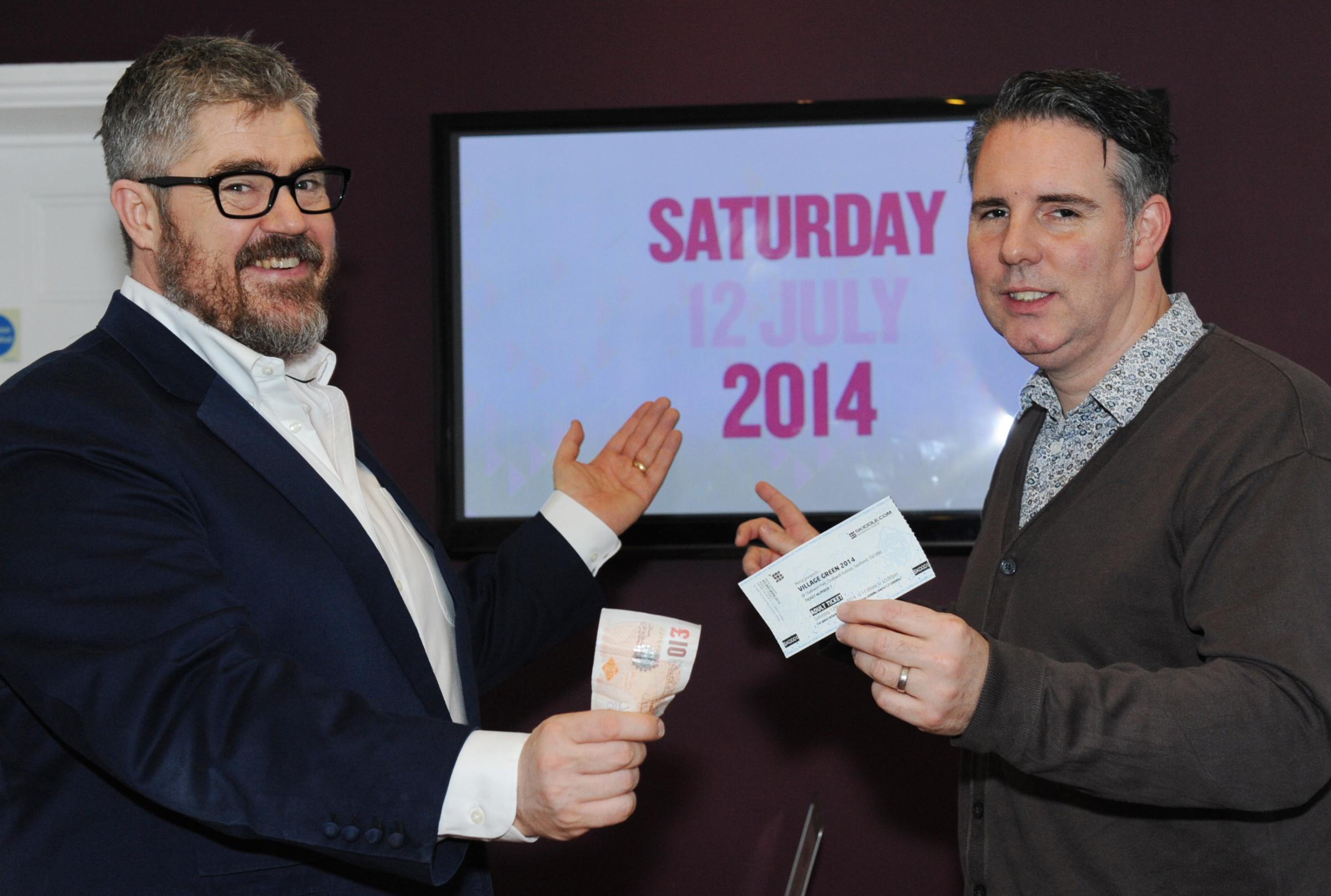 Leigh's Phill Jupitus buying the first ticket to Village Green 2014