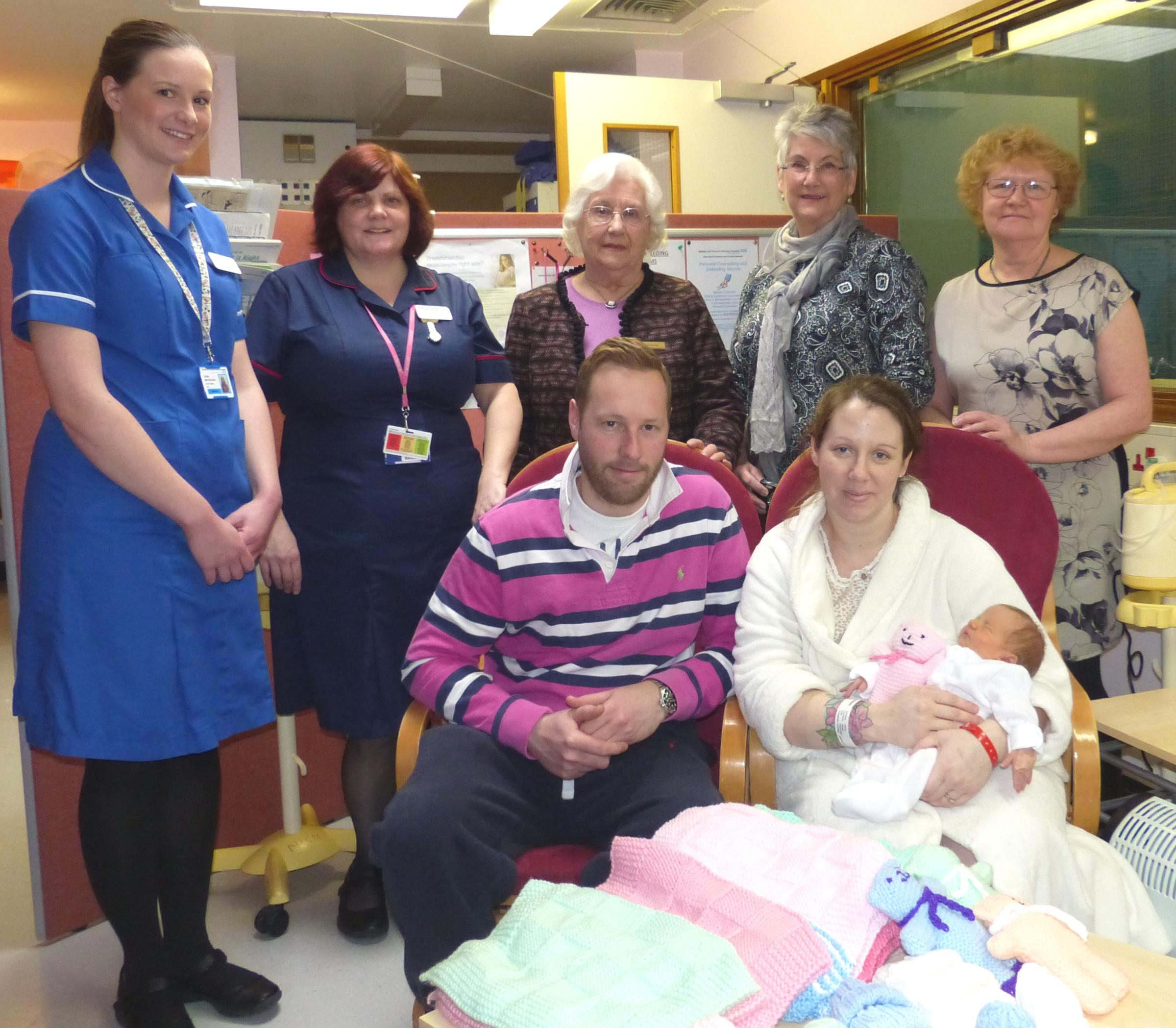 Baby love – staff nurse Fiona Nicholson, senior sister Wendy Rogers, guild chairman Sheila Poyner, Stephanie Thompson and fellow member Tricia Marshall, with Luke and Natalie Finch and Willow Rose