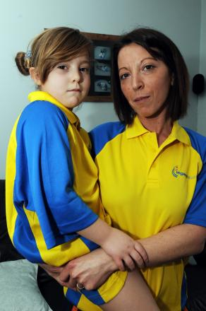 Borrowed clothes – Dee Harrison and five-year-old daughter, Gabriella in the Legacy Leisure shirts they had to wear home from the pool