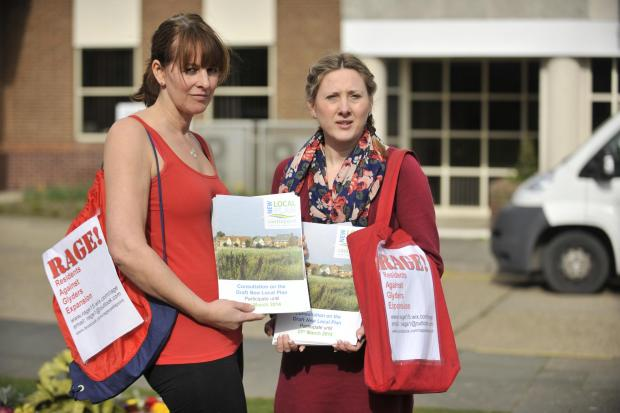 Southend Standard: Do it yourself – Karen Robinson, left, and Jo Hannah pick up leaflets at the council offices