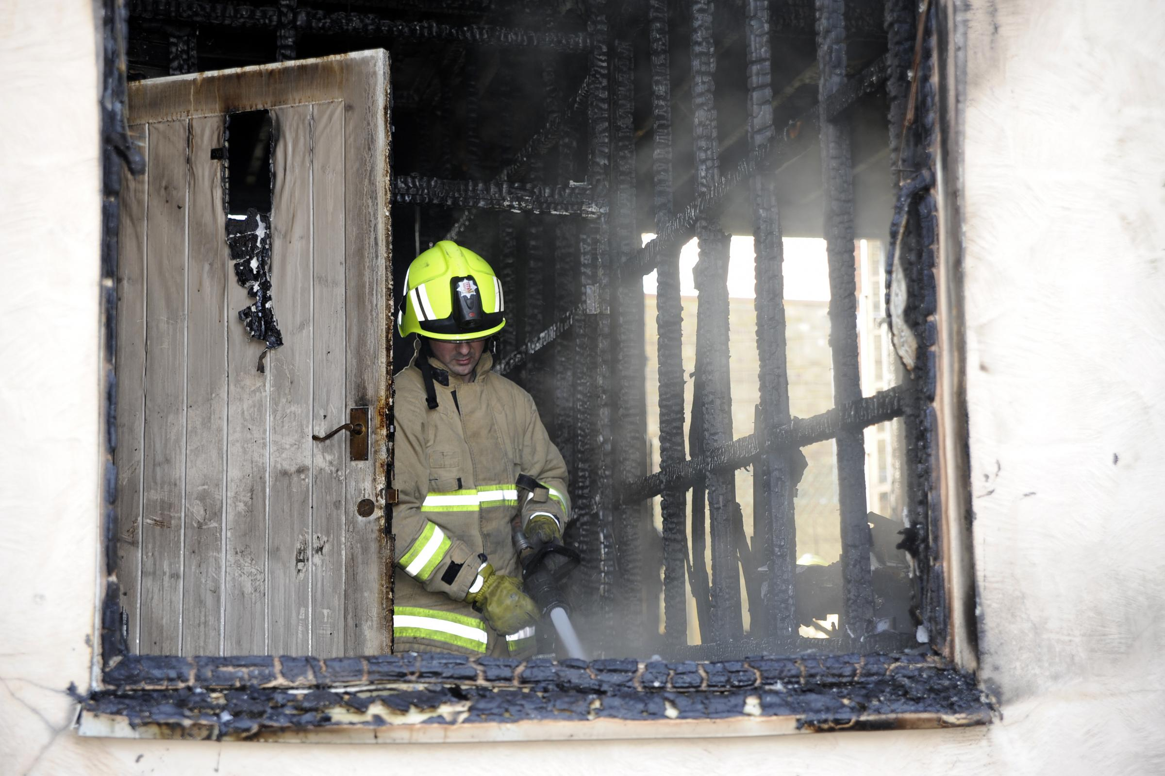 A firefighter at the scene on Monday. Pictures by Alistair Underwood