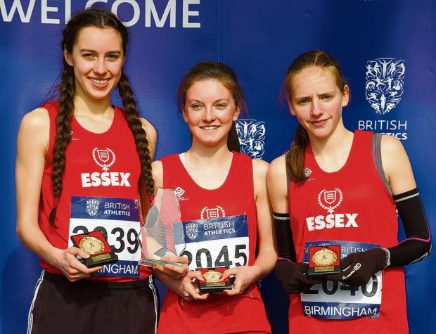 Lydia Hallam, Katie Solis and Gemma Holloway collect their gold medals