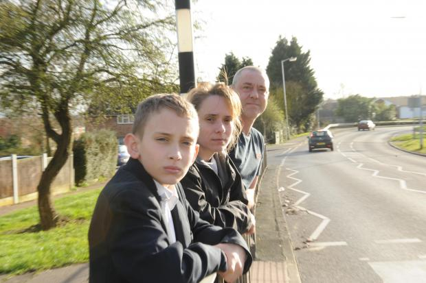 Concerned – Clare and Steve Perry with son River at the crossing where he was knocked over