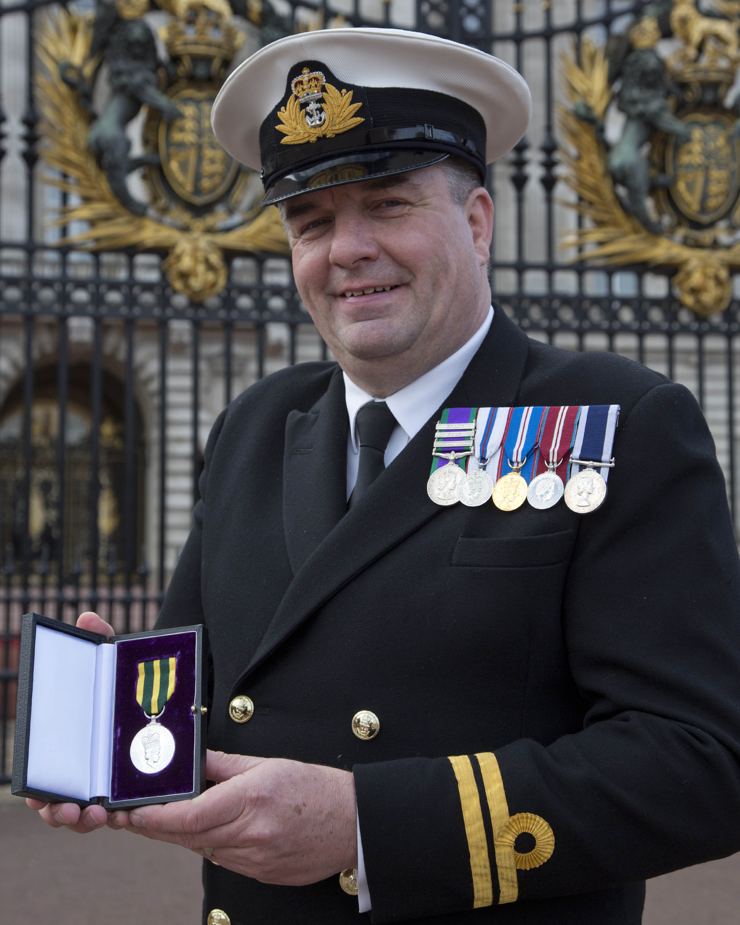 'Jim Hawkins' collects medal at the palace