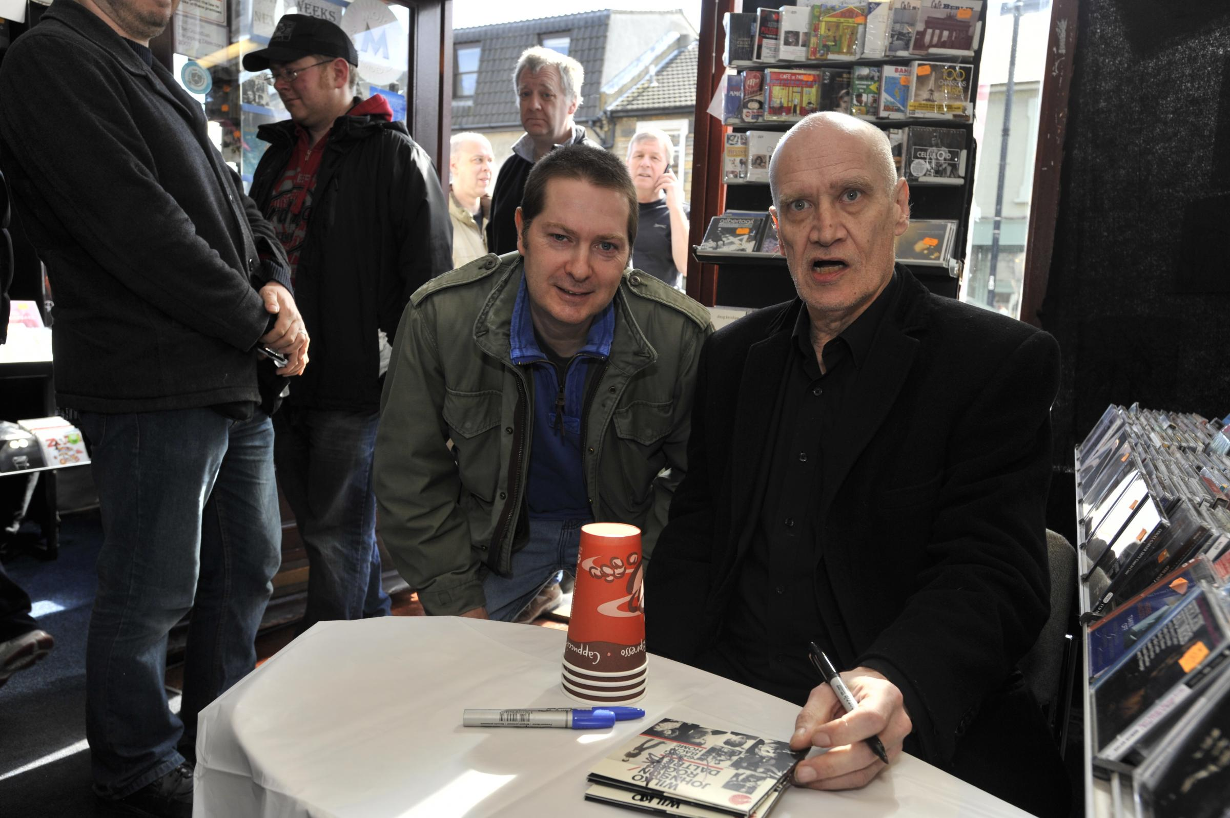 Wilko with a fan at Fives Records in Leigh