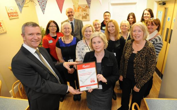 Well done - councillor Nigel Holdcroft and Savs chief executive Alison Semmence with staff and award