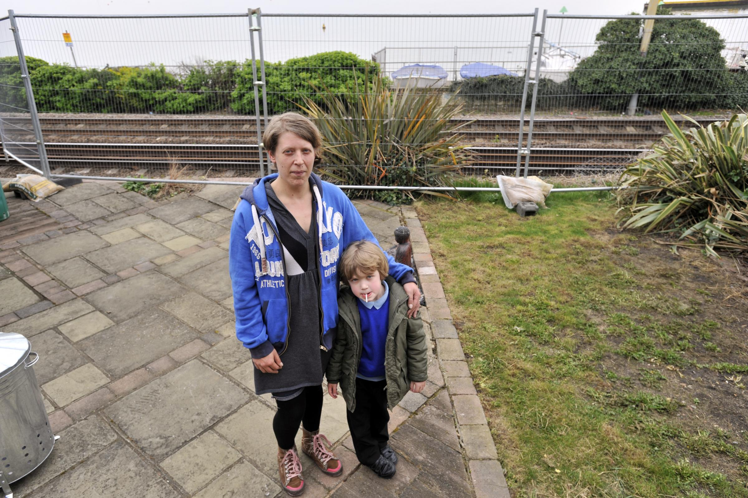Relieved – Rebecca Mansfield and her son George behind the new fence