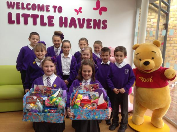 With love – Eli Langley and Francesca Hicks, with other children from Heycroft school, presenting the bath toys