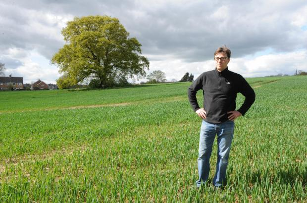 Not here – green belt campaigner Clive Aldous in field where developers want to build homes off Outwood Farm Road, Billericay