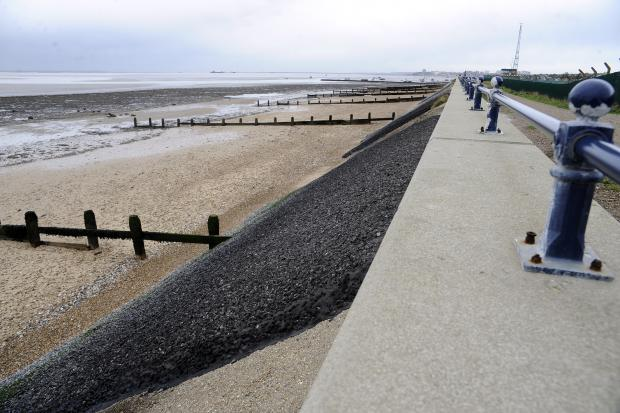 Seawall wins approval despite opposition