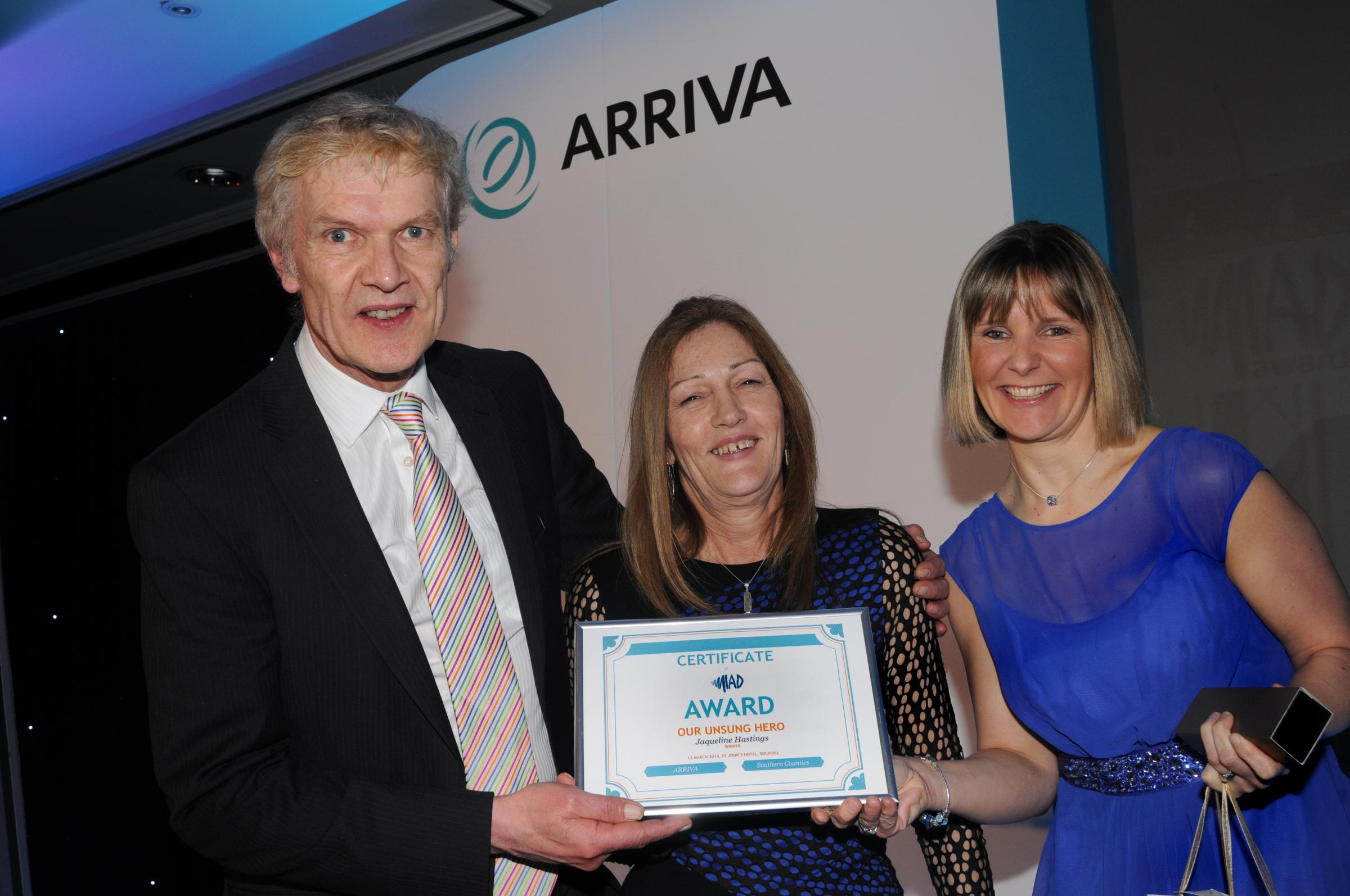 Hartley Milner and Rachel Baldwin present Jacqueline Hastings with her award