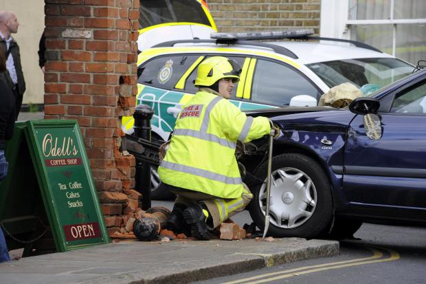 Fire crews rescue man who crashed car into house
