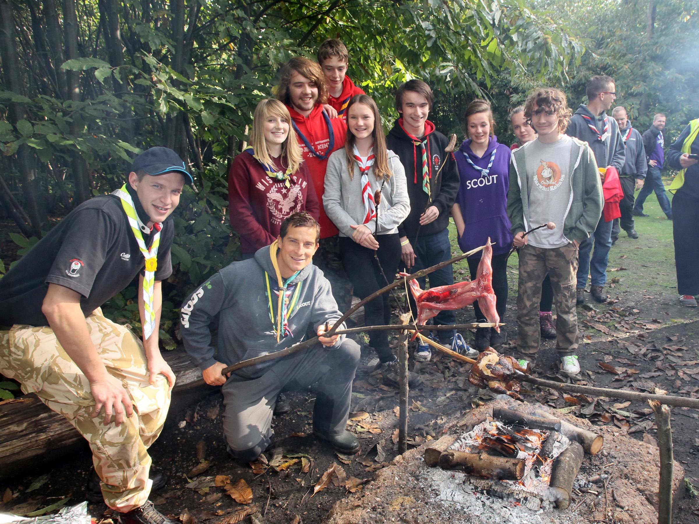 Bear in the woods – Bear Grylls at Thorrington Scout camp, and, inset, Holly and Charlie Luckin and Billy Piercy