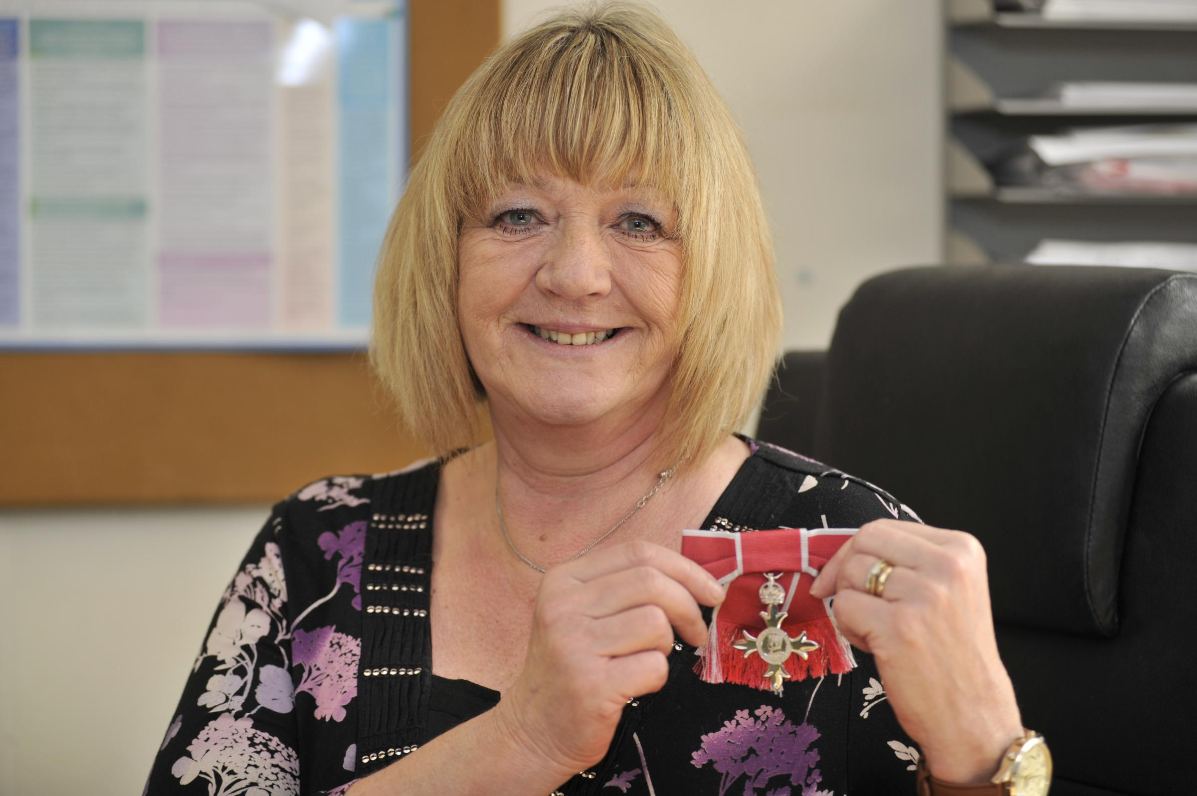 Carol with her MBE insignia