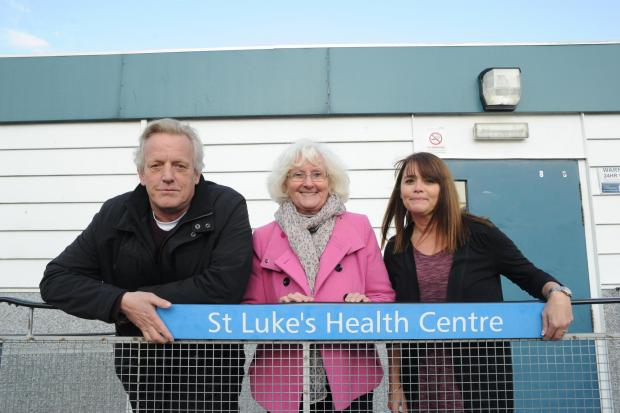 Councillors Paul Van Looy, Sally Carr and practice manager Lorna Salmon outside the health centre